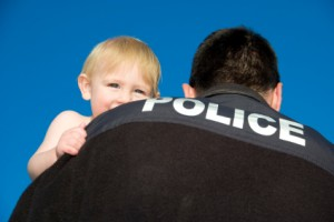 Police Officer Holds baby